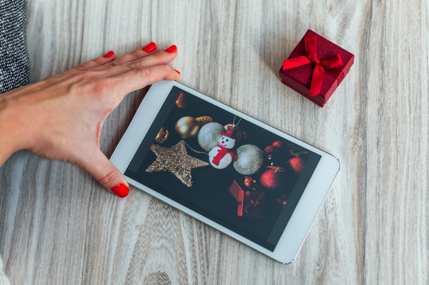 Women looking Christmas ideas for decoration on a tablet