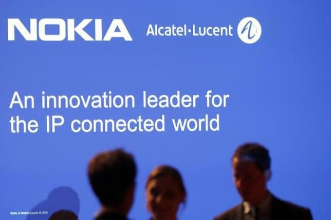 Media people attend a news conference with Nokia and Alcatel-Lucent in Paris
